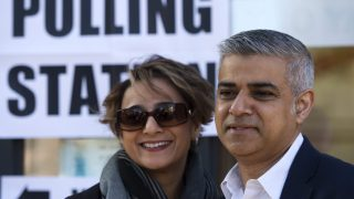 epa05290243 The Labour party candidate for Mayor of London Sadiq Khan (R) poses with his wife Saadiya Khan (L) after voting at a polling station in south London, Britain, 05 May 2016. Britons are voting in local elections across the UK today.  EPA/HANNAH MCKAY