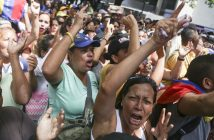 epa05329131 Demonstrator chant slogans during a protest against Venezuelan President Nicolas Maduro's government, outside the Supreme Tribunal of Justice (TSJ), in Caracas, Venezuela, 25 May 2016. The opposition staged a protest against a Venezuelan Supreme Court ruling that bans 'unauthorized acts, marches, protests (and) gatherings,' as well as 'violent demonstrations' at election offices. The opposition wants to hold a referendum to recall President Nicolas Maduro from office, but the government contends that it will be impossible to hold the referendum this year.  EPA/Cristian Hernandez
