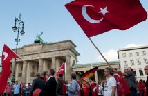 epa05334168 A demonstration march of several Turkish associations passes the Brandenburg Gate in Berlin,Germany, 28 May 2016. The demonstration was organized by several Turkish associations and is directed against the Bundestag vote on an Armenia Resolution on 02 June 2016.  EPA/Klaus-Dietmar Gabbert