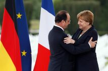 epa05336309 French President Francois Hollande (L) greets German Chancellor Angela Merkel (R) after delivering speeches in the Douaumont's Ossuary during a centenary of the battle of Verdun in Douaumont, France, 29 May 2016.  The Battle of Verdun in World War I between German and French troops saw the deaths of more than 300,000 soldiers on both sides in 1916. The town in the northeast of France became the epitome of brutal trench warfare during the First World War.  EPA/MATHIEU CUGNOT