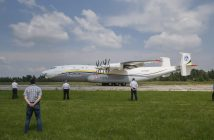 epa05337563 People watch an Ukrainian Antonov An-22A 'Antei' aircraft preparing to take off from the Antonov factory's airport 'Svyatoshyn', in Kiev, Ukraine, 30 May 2016. The An-22A transport plane was originally made in 1974 and restored in 2016 by the Antonov factory for commercial using after it was grounded for about seven years. The heavy military transport aircraft, designed more than 50 years ago by the Antonov Design Bureau in the then Soviet Union, is the biggest airplane with turboprop engines and contra-rotating double propellers in the world.  EPA/SERGEY DOLZHENKO