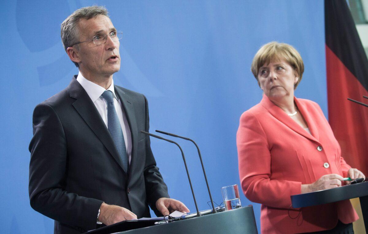 Йенс Столтенберг и Ангела Меркел снимка: БГНЕС