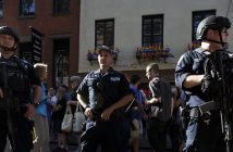 epa05360623 Members of the New York Police Department's Counter-terrorism Team stand guard as people gather for a vigil for the victims of a mass shooting at an Orlando, Florida gay club outside of the Stonewall Inn, a famous gay bar, in New York, New York, USA, 12 June 2016. 50 people were killed in the Orlando attack, and it is being called the worst terrorist attack in the United States since the 9/11 attacks.  EPA/JUSTIN LANE