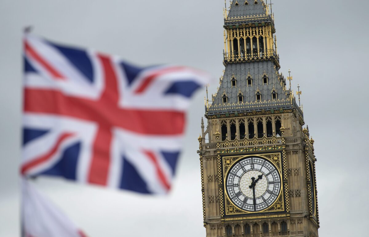 epa05383395 A British Union flag, commonly known as a Union Jack, flies in in front of the landmark Big Ben, in London, Britain, 22 June 2016. Britons will vote on whether to remain in or leave the EU in a referendum on 23 June 2016. EPA/HANNAH MCKAY