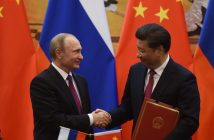 epa05389558 Russian President Vladimir Putin (L) changes documents with Chinese President Xi Jinping at the end of a joint press briefing in Beijing's Great Hall of the People on June 25, 2016.  EPA/GREG BAKER