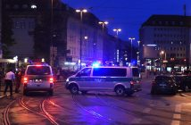epa05437237 Policemen and police vehicles standing standing at the central station in Munich, Germany, 22 July 2016. After a shootout in the Olympia shopping centre in Munich, injuries and possible deaths were reported by the police.  EPA/FELIX HOERHAGER