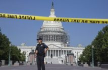 epa05415214 A US Capitol Police officer stands on duty behind a police cordon outside the US Capitol Building while it is on lockdown, in Washington, DC, USA, 08 July 2016. The Capitol building and visitor center were on lockdown alert as police searched for an individual, according to media reports.  EPA/MICHAEL REYNOLDS