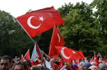 epa05428091 Demonstrators with Turkish flags at a demonstration against the failed attempted coup in Turkey, outside the Turkish embassy in Berlin, Germany, 16 July 2016. Turkish Prime Minister Yildirim declared that the government has regained control after an attempted military coup d'etat. According to reports, at least 161 people died and 2,893 soldiers who allegedly supported the coup, were detained. According to further reports, Turkish President Erdogan has denounced the coup attempt as an 'act of treason' and insisted his government remains in charge.  EPA/PAUL ZINKEN .