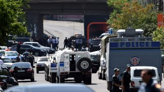 epa05429603 Armenian police officers with armored vehicles block the street during a special operation to release police officers taken hostage at the seized police station in the district of Erebuni in Yerevan, Armenia, 17 July 2016. A group of armed men which seized a police station to demand the release of opposition politician, a member of the Nagorno-Karabakh conflict and the leader of a new Armenian Public Salvation Front Zhirayr Sefilyan, who was arrested for the obtaining and storage of firearms.  EPA/HAYK BAGHDASARYAN/PHOTOLURE