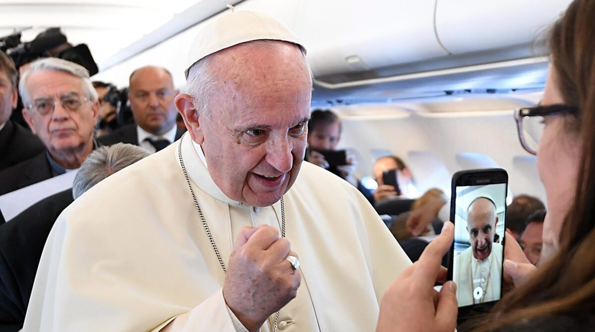 epa05443601 Pope Francis on board a plane during his flight to Balice Airport for the World Youth Day 2016 in Krakow, Poland, 27 July 2016. The World Youth Day 2016 is held in Krakow and nearby Brzegi from 26 to 31 July.  EPA/DANIEL DAL ZENNARO