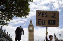 A demonstrator holds a placard during a protest against the outcome of the UK's June 23 referendum on the European Union (EU), in central London on June 25, 2016. The result of Britain's June 23 referendum vote to leave the European Union (EU) has pitted parents against children, cities against rural areas, north against south and university graduates against those with fewer qualifications. London, Scotland and Northern Ireland voted to remain in the EU but Wales and large swathes of England, particularly former industrial hubs in the north with many disaffected workers, backed a Brexit. / AFP / JUSTIN TALLIS        (Photo credit should read JUSTIN TALLIS/AFP/Getty Images)