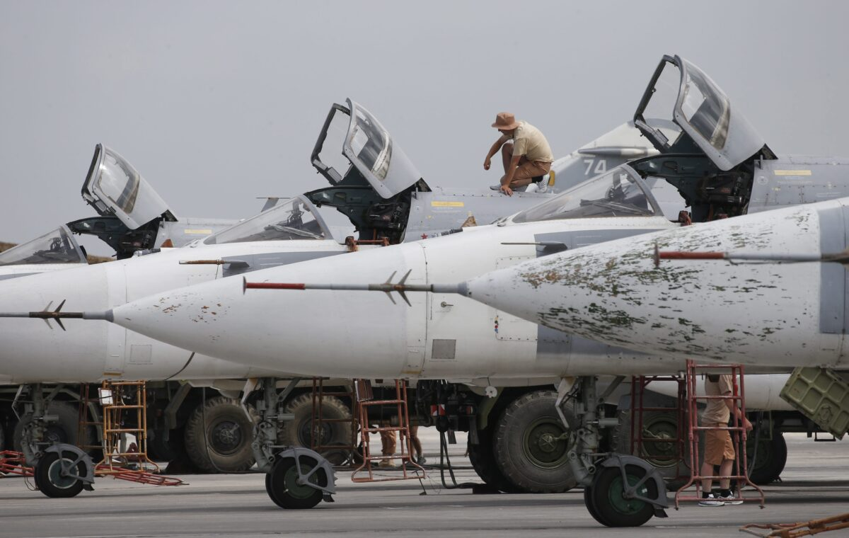 epa05289980 Russian technicians maintain Su-24 bombers at Hmeimym airbase in Latakia province, Syria, 04 May 2016. Hmeimym airbase serves as the base of operation for the Russian air force in Syria. The United States and Russia have agreed to extend the cease-fire in Syria to the city of Aleppo, the US State Department reported on 04 May. EPA/SERGEI CHIRIKOV