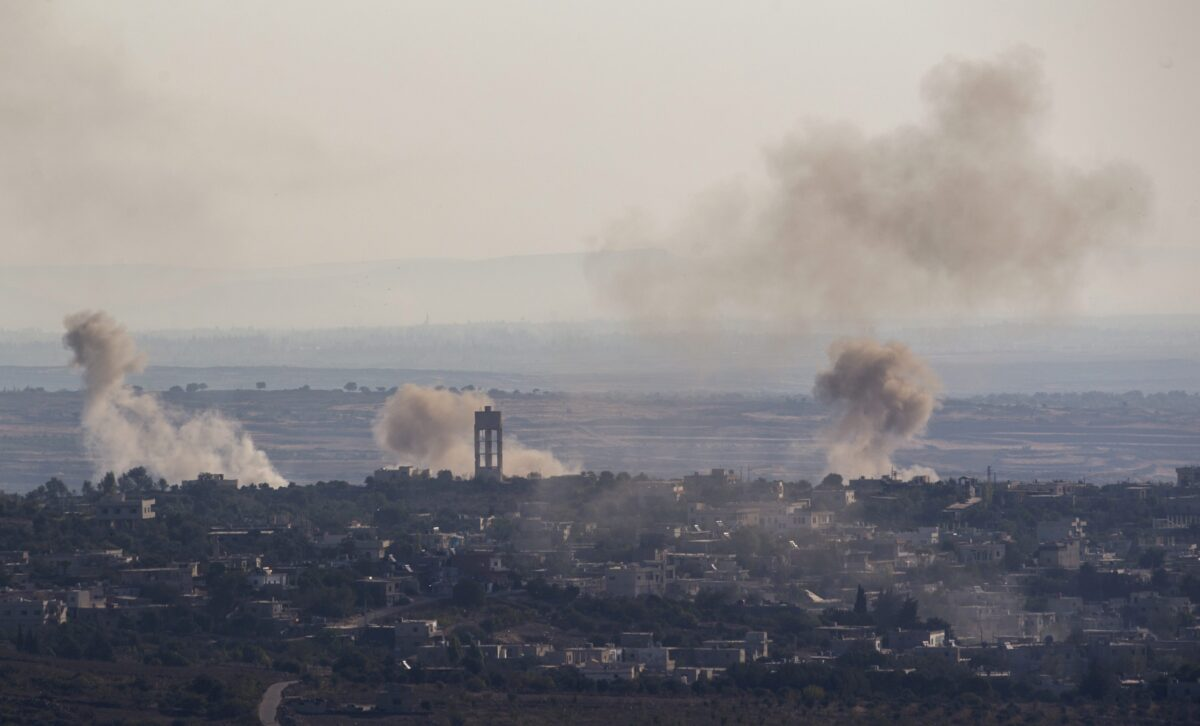 epa05534684 An image taken from the Israeli side of the border with Syria on 11 September 2016, shows smoke rising from the village of Jubata, controlled by Islamic rebels, north of Quneitra, Syria, during the third day of fighting between the Syrian army loyal to the Syrian President Bashar Al Assad and Islamic rebels continue to clash over the border territory. EPA/ATEF SAFADI