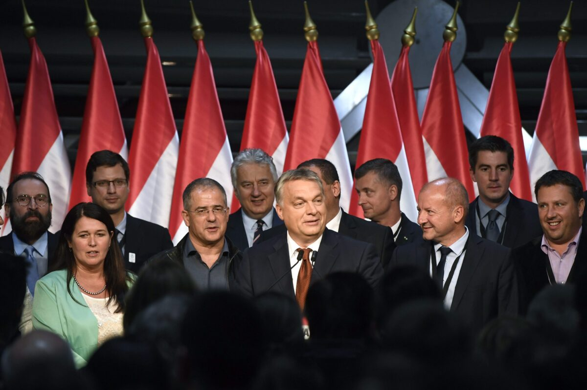 epa05567370 Hungarian Primie Minister Viktor Orban (C) delivers his speech during the Fidesz party's event after the referendum in the Balna Budapest Cultural Center in Budapest, Hungary, 02 October 2016. Hungary held a referendum on the European Union's proposed migrant quota scheme to oppose the mandatory resettling of refugees in the country. Early reports suggest that voter turnout did not exceed 50 percent, which would make the result invalid. EPA/SZILARD KOSZTICSAK HUNGARY OUT