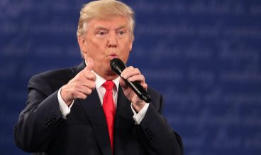 epa05579082 Republican Donald Trump during the second Presidential Debate at Washington University in St. Louis, Missouri, USA, 09 October 2016. The third and final debate will be held 19 October in Nevada.  EPA/ANDREW GOMBERT