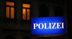 epa05579210 A sign reading 'Polizei' (Police) shines in the morning at the Police Directorate in Leipzig, Saxony, Germany, 10 October 2016. Fugitive terror-suspect Jaber al-Bakr was arrested in the night in Leipzig. The 22-year-old Syrian had been on the run since an anti-terrorist raid on 08 October, in Chemnitz. Several hundred grams of explosives were reportedly found during a search in an apartment where al-Bakr was staying.  EPA/JAN WOITAS