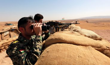 epa05588279 (FILE) A file picture dated 10 October 2016 shows Iraqi Kurdish Peshmerga fighters aiming their weapons near the town of Bashiqa, the frontline of fighting between Kurdish forces and militants from the so-called Islamic State group (IS or ISIS), 150 Km northeast of Erbil, Iraq. Iraqi Prime Minister Haider al-Abadi said on 17 October 2016, that Iraqi forces started their military offensive to recapture the city of Mosul from IS. The operation, led by Kurdish Peshmerga, Iraqi government forces and allies, is backed by the US-led coalition. Iraq's second largest city, Mosul, fell under the jihadist militant group's control in June 2014.  EPA/AHMED JALIL