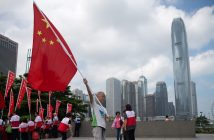 epa05603152 A protesters displays a Chinese flag as during a rally outside the Legislative Council chamber in Hong Kong, China, 26 October 2016. Hundreds of pro-government supporters gathered outside the Legislative Council building and Tamar Park calling for the disqualification of Youngspiration party lawmakers-elect Sixtus 'Baggio' Leung and Yau Wai-ching.  EPA/JEROME FAVRE