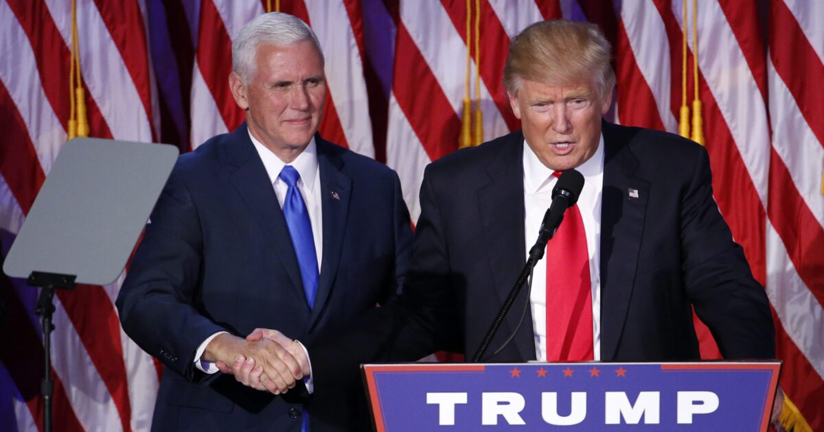 epa05623718 US Republican presidential nominee Donald Trump (C) shakes hands with running mate Mike Pence (L) as he delivers a speech on stage at Donald Trump's 2016 US presidential Election Night event as votes continue to be counted at the New York Hilton Midtown in New York, New York, USA, 08 November 2016.  EPA/SHAWN THEW