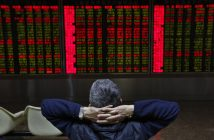 epa05623738 Chinese investors look at an electronic screen showing market movements at a stock brokerage house in Beijing, China, 09 November 2016. Asian shares fall as Donald Trump leads Hillary Clinton in the electoral vote count to become President of the United States.  EPA/HOW HWEE YOUNG