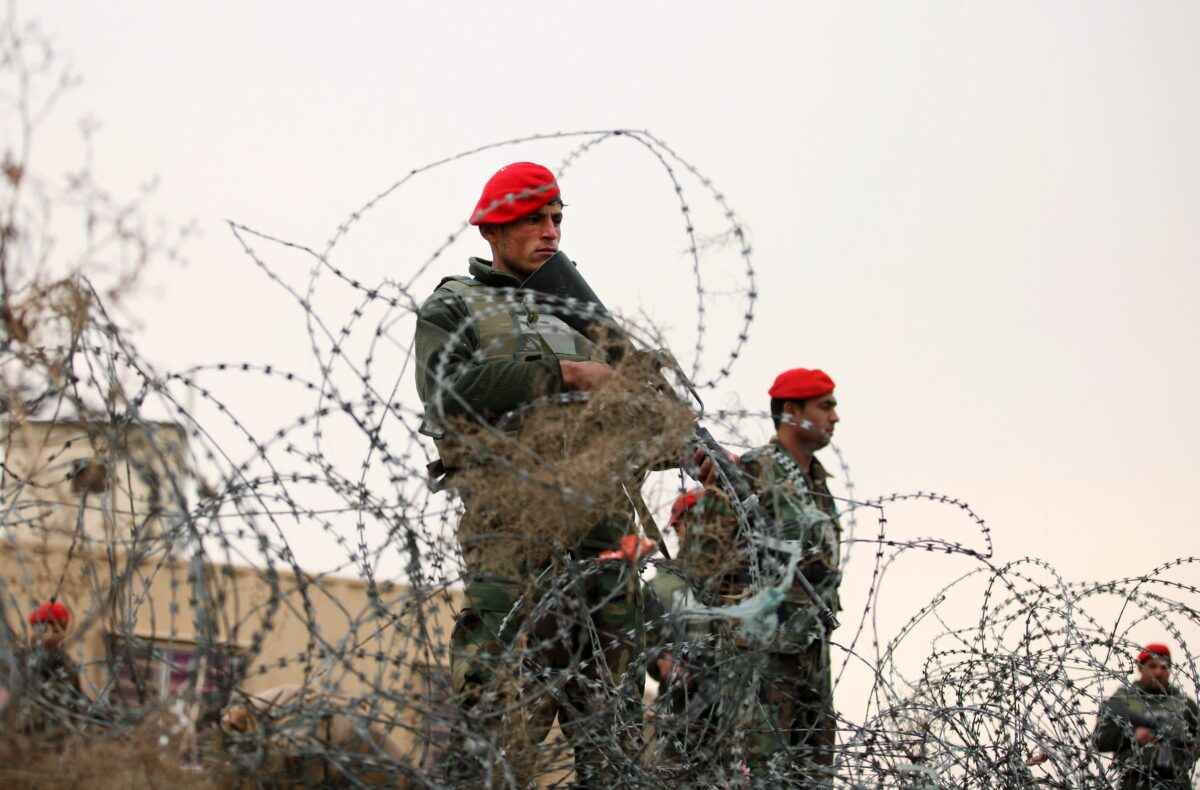 epa05627835 (FILE) A file photograph showing members of the Afghan security services standing guard on a roadside amid intensified security following a suicide attack targeting a US troop convoy near Bagram airbase, in Kabul, Afghanistan, 22 December 2015. Media reports on 12 November 2016 that explosion has killed at least four people and injured 14 others at the Bagram airbase. The Taliban have stated they carried out the attack by a suicide bomber. EPA/HEDAYATULLAH AMID *** Local Caption *** 52483557