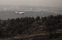 epa05648505 The USA fire fighting super tanker known as 'Global Supertanker' and bearing the tail number 944 flies low before going behind a hill outside Neve Ilan, Israel, west of Jerusalem on 26 November 2016 as it assists in fire fighting in Israel following days of fires from Haifa in the north to the outskirts of Jerusalem. The plane circled once and then flew low behind the hill, but it is not  known if the plane dropped its load of water or flame retardant when behind the hill. Behind is the city of Modi'in, half way between Jerusalem and Tel Aviv (not seen).  EPA/JIM HOLLANDER