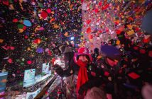 Revellers toss confetti over Times Square from a hotel after the clock struck midnight during New Year's Eve celebrations in New York January 1, 2015. REUTERS/Keith Bedford