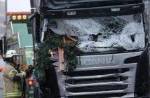 A fire fighter stands beside the truck. REUTERS/Hannibal Hanschke
