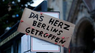 "A placard reading ""The heart of Berlin was hit"" is placed in Berlinl. REUTERS/Hannibal Hanschke"