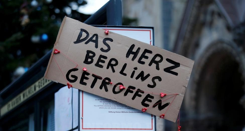 """A placard reading """"The heart of Berlin was hit"""" is placed in Berlinl. REUTERS/Hannibal Hanschke"""