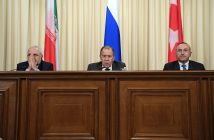 epa05683625 Iranian Foreign Minister Mohammad Javad Zarif, Russian Foreign Minister Sergei Lavrov and Turkish Foreign Minister Mevlut Cavusoglu attend a press conference in Moscow, Russia, 20 December 2016. Russia, Iran and Turkey agreed to guarantee Syria peace talks and backed expanding a ceasefire in the war-torn country, Russian foreign minister said after talks with counterparts.  EPA/NATALIA KOLESNIKOVA / POOL