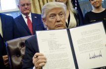 epa05758009 US President Donald J. Trump(C) holds up one of the executive actions that he signed in the Oval Office in Washington, DC, USA, 28 January 2017. The orders outline a reorganization of the National Security Council, implement a five year lobbying ban on administration officials and a lifetime ban on administration officials lobbying for a foreign country and calls on military leaders to present a report to the president in 30 days that outlines a strategy for defeating ISIS.  EPA/PETE MAROVICH / POOL