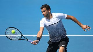 MELBOURNE, AUSTRALIA - JANUARY 19:  Grigor Dimitrov of Bulgaria plays a forehand in his first round match against Dustin Brown of Germany during day one of the 2015 Australian Open at Melbourne Park on January 19, 2015 in Melbourne, Australia.  (Photo by Patrick Scala/Getty Images)