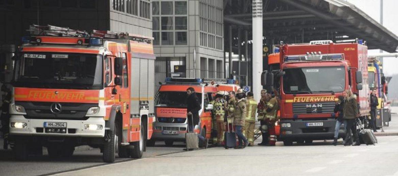 Firemen are seen outside the Helmut Schmidt airport in Hamburg, Germany February 12, 2017. REUTERS/Fabian Bimmer