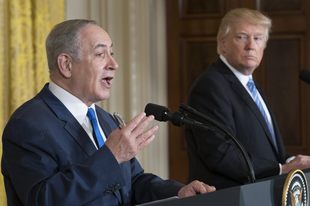 epa05795482 Israeli Prime Minister Benjamin Netanyahu (L), with US President Donald J. Trump (R), responds to a question from the news media during a joint press conference in the East Room in of the White House in Washington, DC, USA, 15  February 2017. This is the first official meeting of the two leaders since President Trump has taken office.  EPA/SHAWN THEW