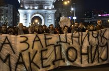 epa05819448 Supporters of the Internal Macedonian Revolutionary Organization – Democratic Party for Macedonian National Unity (VMRO DPMNE) carry a banner on which is written 'For common Macedonia' and shout the slogans during a protest in front of the Parliament building in Skopje, The Former Yugoslav Republic of Macedonia, 27 February 2017. VMRO-DPMNE supporters have mobilized for protests against the formation of a possible government between the opposition Social democrats and the main Albanian party, Democratic Union for Integration claiming that their coalition deal that includes Albanian becoming an official language, will break up the country. The protest comes after VMRO-DPMNE's leader Nikola Gruevski on 26 February 2017 called on the people to defend the country he alleges is under attack.  EPA/GEORGI LICOVSKI