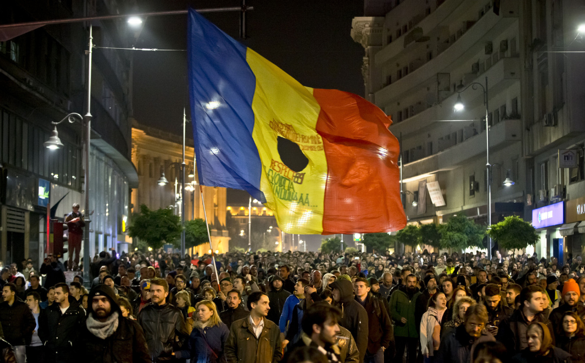 Romanians fill the Calea Victoriei, a main avenue of the Romanian capital, during a large protest in Bucharest, Romania, Tuesday, Nov. 3, 2015. More than 10,000 marched down the city's main boulevards and then massed outside the government offices Tuesday evening calling for the resignation of Prime Minister Victor Ponta, Interior Minister Gabriel Oprea and the mayor of the district where the Colectiv nightclub, the venue of a deadly fire last week, was located.(AP Photo/Vadim Ghirda)