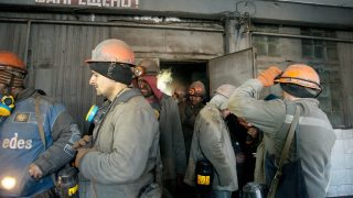 epa05762968 Miners of the Zasyadko coal mine, who were blocked underground, leave a mine elevator in Donetsk, Ukraine, 31 January 2017. All 207 miners were evacuated from the Zasyadko coal mine on the pro-Russian separatist controlled territory after it lost its power supply, allegedly as a result of shelling.  EPA/ALEXANDER ERMOCHENKO