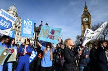 epa05828959 'Our NHS' demonstrators march toward parliament in London, Britain, 04 March 2017. Tens of thousands of protesters marched on parliament during a national demonstration calling for the government to defend the National Health Service (NHS).  EPA/ANDY RAIN