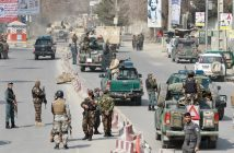 epa05835560 Armed Afghan security officials secure the surroundings of the Sardar Daud Khan's Hospital, also known as Kabul Military Hospital, during an attack by suspected militants in Kabul, Afghanistan, 08 March 2017. According to reports, blasts and ongoing gunfire were heard at the hospital. The number of causalities is yet unknown.  EPA/HEDAYATULLAH AMID