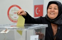 epaselect epa05873082 A woman casts her vote for the Turkish constitution referendum, in the Turkish consulate general in Cologne, Germany, 27 March 2017. About 500,000 voters in North Rhine-Westphalia with a Turkish passport are eligible to participate in the Turkish referendum since 27 March 2017. A constitutional referendum is due to be held in Turkey on 16 April 2017. Voters are to decide on whether to replace the parliamentary system with a presidential system that would give widespread powers to President Erdogan.  EPA/SASCHA STEINBACH
