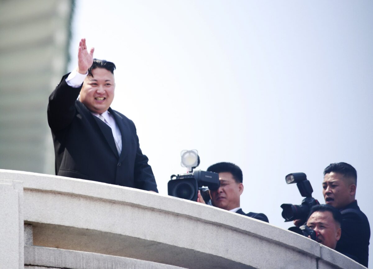 epaselect epa05908577 North Korean leader Kim Jong-un (L) waves during a parade for the 'Day of the Sun' festival on Kim Il-Sung Square in Pyongyang, North Korea, 15 April 2017. North Koreans celebrate the 'Day of the Sun' festival commemorating the 105th birthday anniversary of former supreme leader Kim Il-sung on 15 April as tension over nuclear issues rise in the region.  EPA/HOW HWEE YOUNG