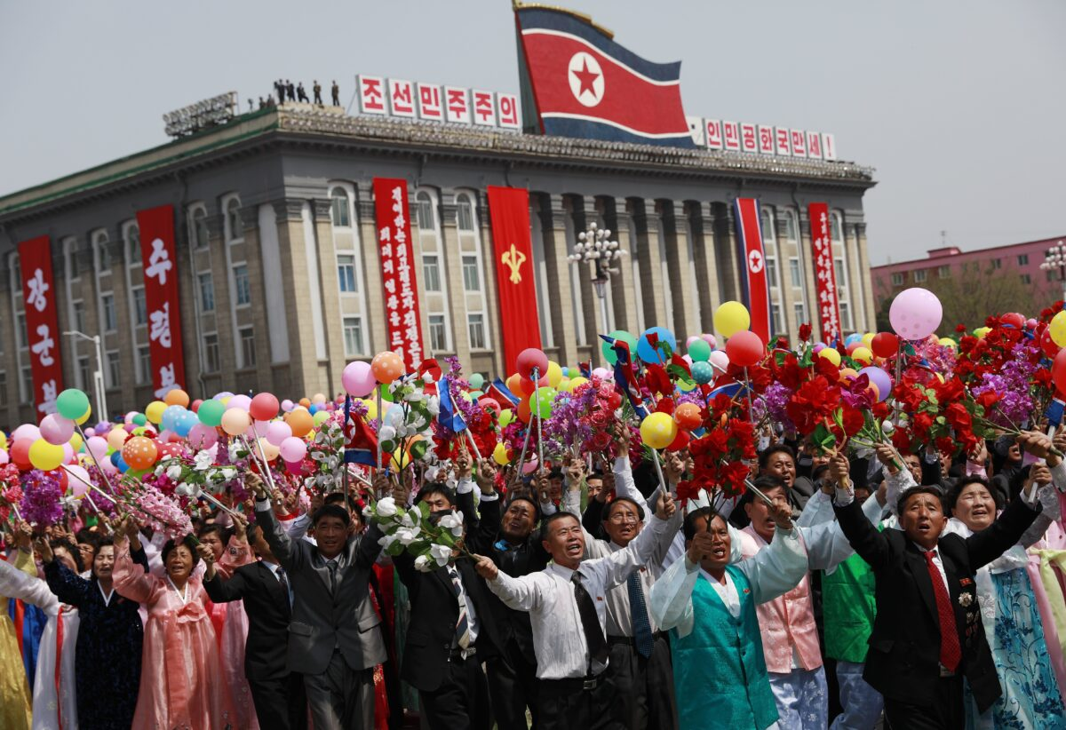 epa05908640 North Korean women and men cheer and wave as they march past during a parade for the 'Day of the Sun' festival on Kim Il Sung Square in Pyongyang, North Korea, 15 April 2017. North Koreans celebrate the 'Day of the Sun' festival commemorating the 105th birthday anniversary of former supreme leader Kim Il-sung on 15 April as tension over nuclear issues rise in the region. EPA/HOW HWEE YOUNG