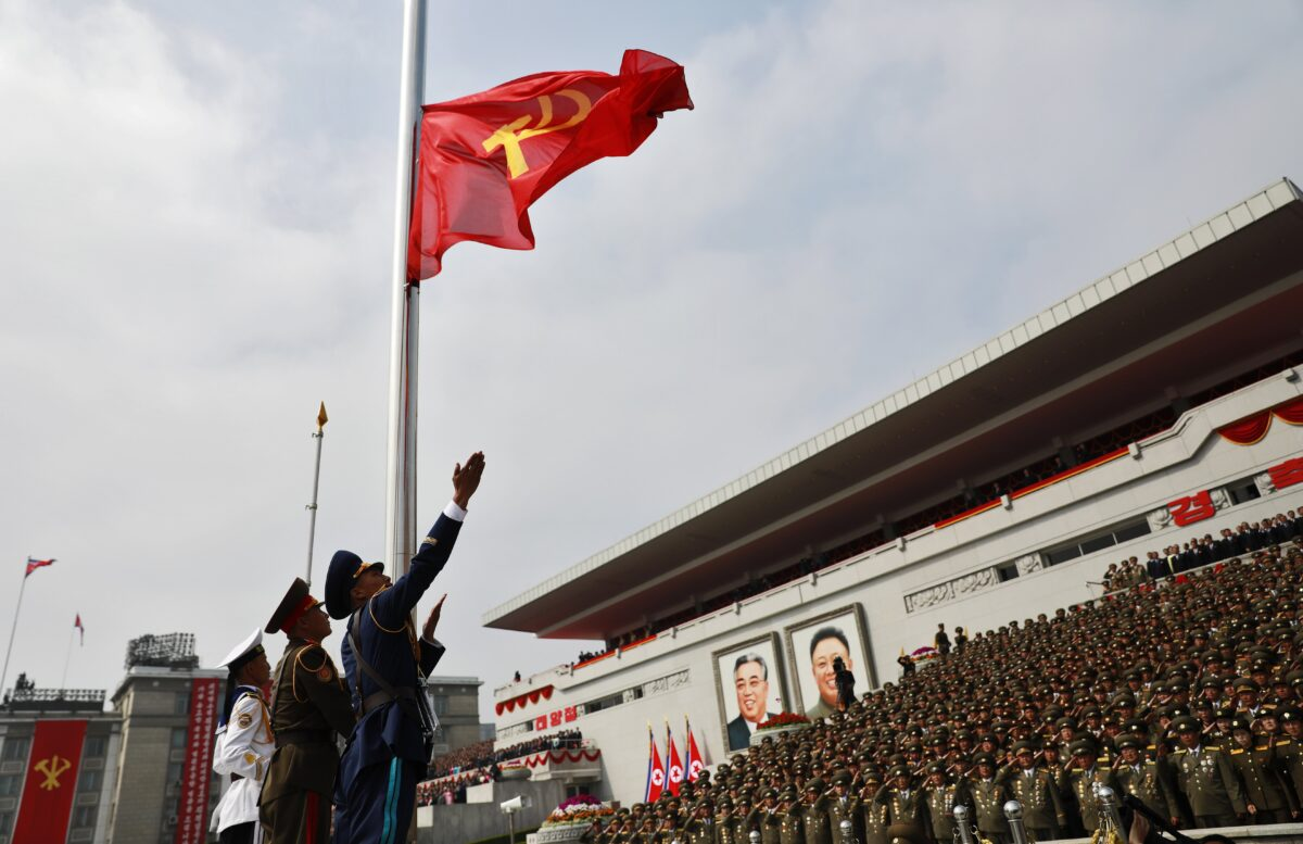 epa05908643 North Korean soldiers hoist the Communist Party flag during a parade for the 'Day of the Sun' festival on Kim Il Sung Square in Pyongyang, North Korea, 15 April 2017. North Koreans celebrate the 'Day of the Sun' festival commemorating the 105th birthday anniversary of former supreme leader Kim Il-sung on 15 April as tension over nuclear issues rise in the region. EPA/HOW HWEE YOUNG