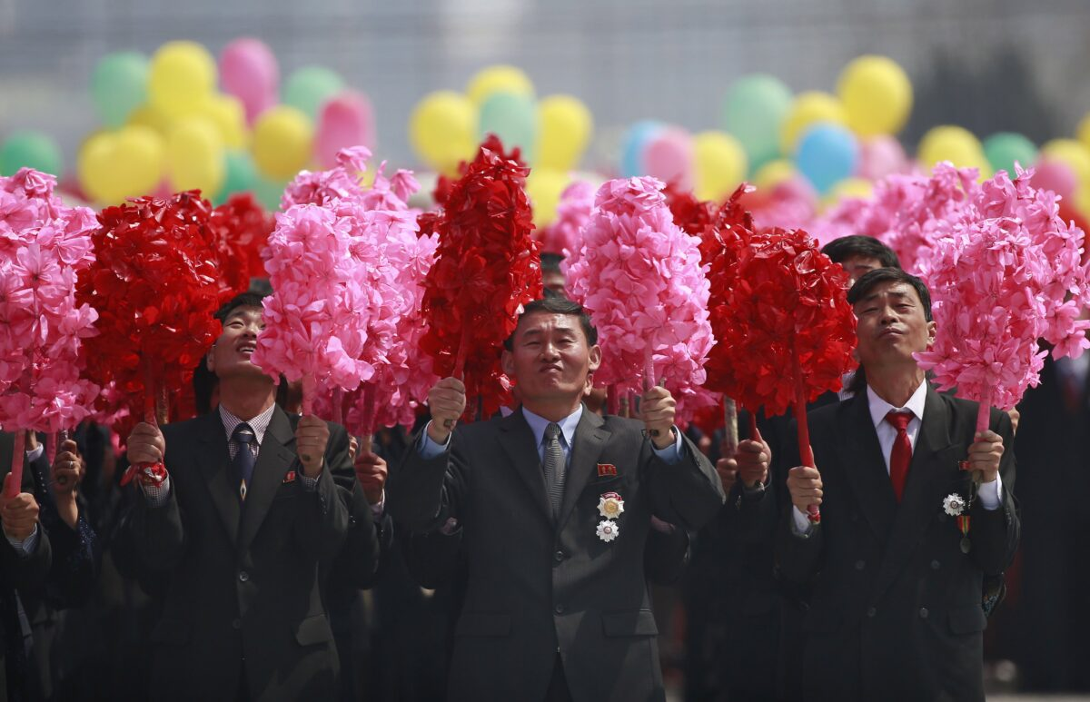 epa05908644 North Korean men carrying pom poms are seen during a parade for the 'Day of the Sun' festival on Kim Il Sung Square in Pyongyang, North Korea, 15 April 2017. North Koreans celebrate the 'Day of the Sun' festival commemorating the 105th birthday anniversary of former supreme leader Kim Il-sung on 15 April as tension over nuclear issues rise in the region.  EPA/HOW HWEE YOUNG