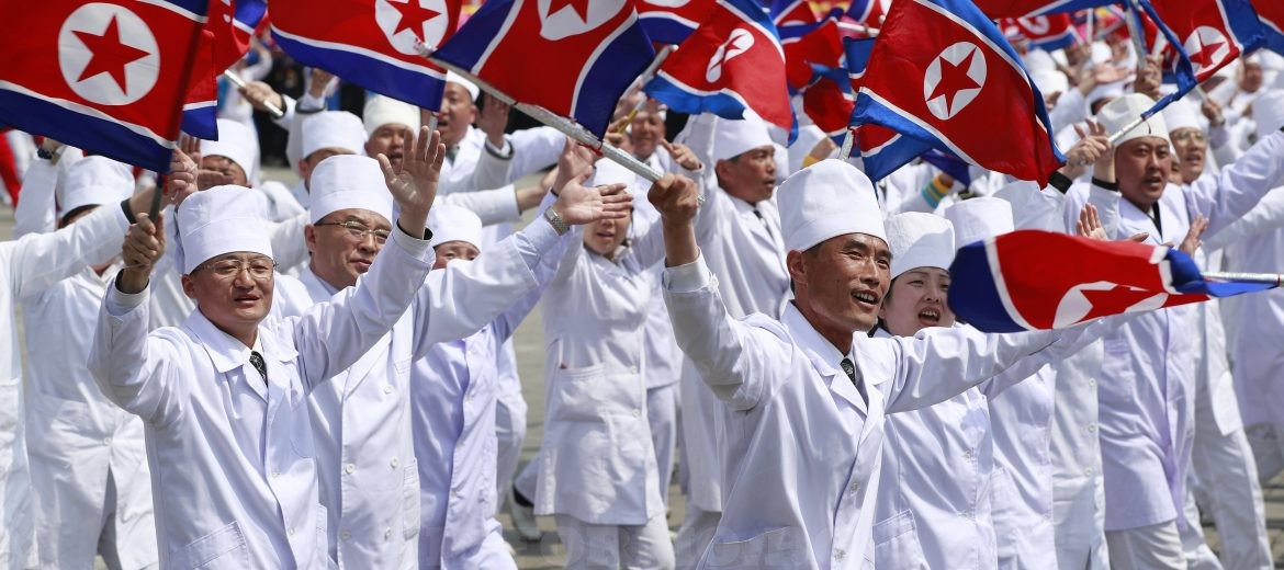 epa05908647 North Korean women and men cheer and wave flags as they march past during a parade for the 'Day of the Sun' festival on Kim Il Sung Square in Pyongyang, North Korea, 15 April 2017. North Koreans celebrate the 'Day of the Sun' festival commemorating the 105th birthday anniversary of former supreme leader Kim Il-sung on 15 April as tension over nuclear issues rise in the region.  EPA/HOW HWEE YOUNG