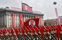 epa05908625 North Korean soldiers march past with a float carrying a picture of former supreme leader Kim Il-sung during a parade for the 'Day of the Sun' festival on Kim Il Sung Square in Pyongyang, North Korea, 15 April 2017. North Koreans celebrate the 'Day of the Sun' festival commemorating the 105th birthday anniversary of former supreme leader Kim Il-sung on 15 April as tension over nuclear issues rise in the region.  EPA/HOW HWEE YOUNG