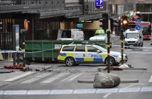 epa05896157 A turned over so called 'Stockholmslejon', a concrete traffic stopper, outside a roped off area where a truck plowed into pedestrians, killing four people and injuring 15 more at the Ahlens department store on Drottninggatan Street in central Stockholm, Sweden, 07 April 2017 (issued 08 April 2017). Media reports that police have arrested a man, 08 April 2017, for the truck attack held on suspicion of 'terrorist crimes through murder', according to the Swedish prosecutor's office.  EPA/JONAS EKSTROMER  SWEDEN OUT