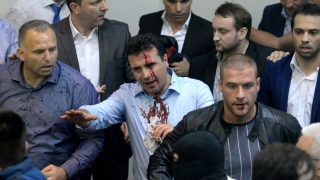 epa05931625 Zoran Zaev (C), the leader of Social Democratic Union of Macedonia with blood on his face tries to leave the Parliament after protestors attacked him after they stormed the Macedonian Parliament in Skopje, The Former Yugoslav Republic of Macedonia on 27 April 2017. President Ivanov didn't give the mandate for a new government, although Zoran Zaev (the leader of SDSM) provided a list of signatures, guaranteeing parliamentary majority he rejected giving him the mandate with explanation that the coalition between Zaev and the Albanian parties (with their platform for two official languages in the country) would destroy the constitutional order in the country.  EPA/STR