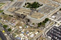 010914-F-8006R-006  Arlington, Va. (Sep. 14, 2001) -- Agents from several federal agencies, fire fighters, rescue workers and engineers work at the Pentagon crash site on Sep. 14, 2001, where a hijacked American Airlines flight slammed into the building on Sep. 11.  The terrorist attack caused extensive damage to the west face of the building and followed similar attacks on the twin towers of the World Trade Center in New York City.   American Airlines FLT 77 was bound for Los Angeles from Washington Dulles with 58 passengers and 6 crew.  All aboard the aircraft were killed, along with 125 people in the Pentagon. DoD photo by Tech. Sgt. Cedric H. Rudisill.  (RELEASED)